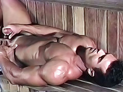 Hot sexy bodybuilder playing with his dick in a sona & cums
