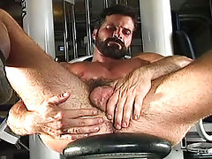 Sexy gay is flexing his strong muscles & gets a big erection